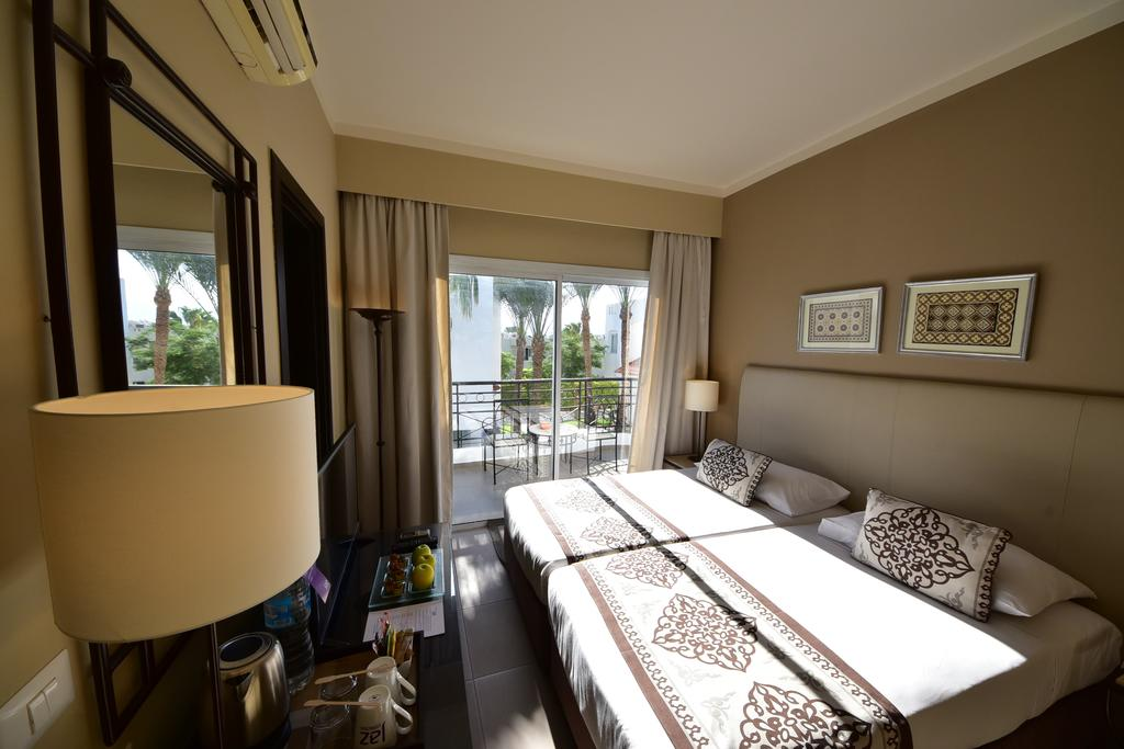 номер отеля Jaz Fanara Resort & Residence