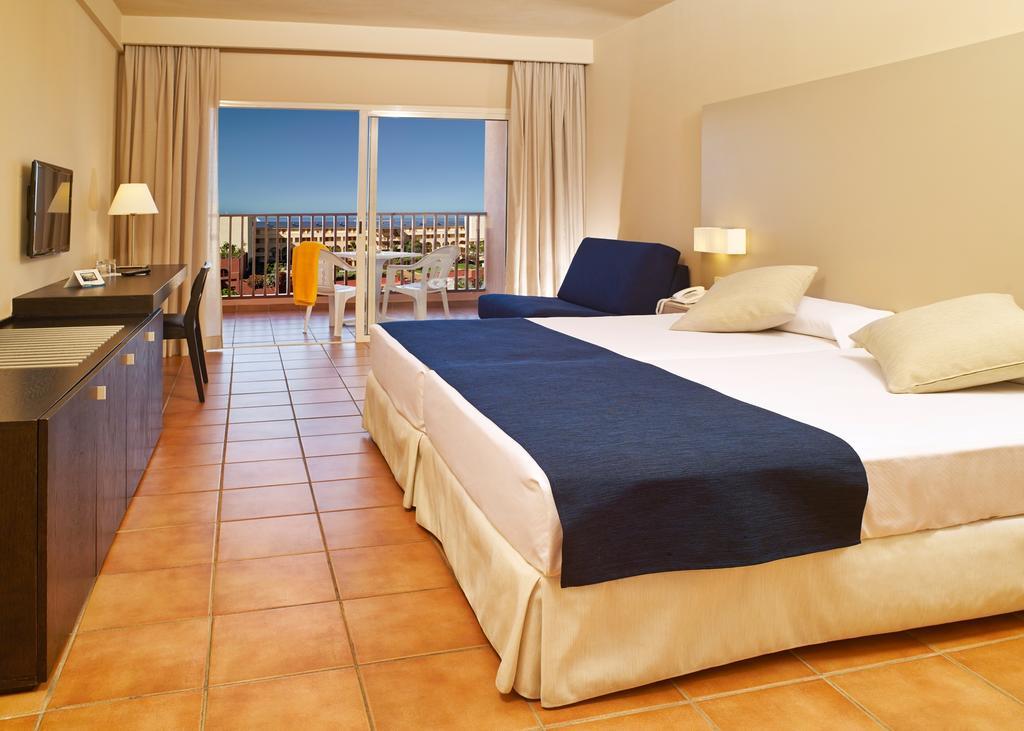 номер отеля Jacaranda Hotel
