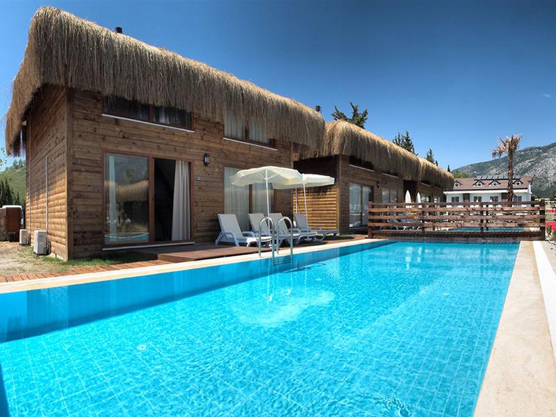номер с выходом к бассейну отеля Sahra Su Holiday Village & Spa