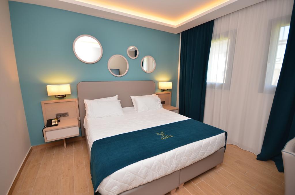 номер отеля Almyros Beach Resort & Spa